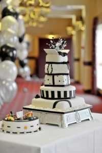 A 5-layer, Modern Black and White Wedding Cake on a table at a wedding reception