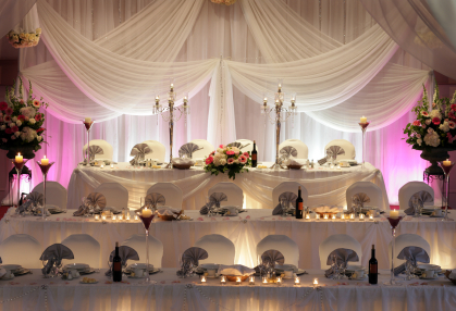 Tiered head table with pink lighting