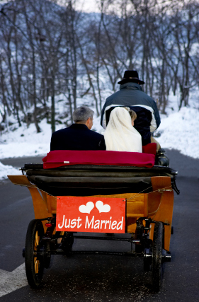 Just Married - Winter Bride and Groom in Open Carriage