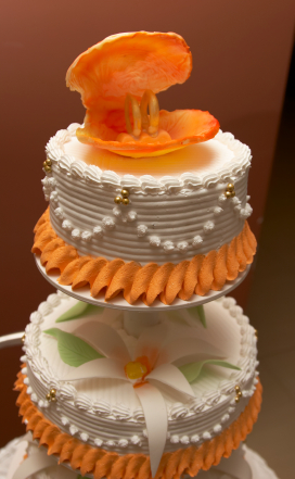 Peach and white beach themed wedding cake