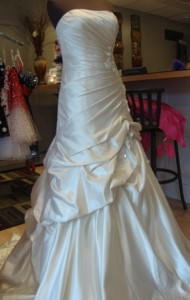 Fit and flatter style wedding gown at a bridal trunk show