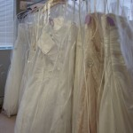 Hanging wedding dresses at a bridal trunk show
